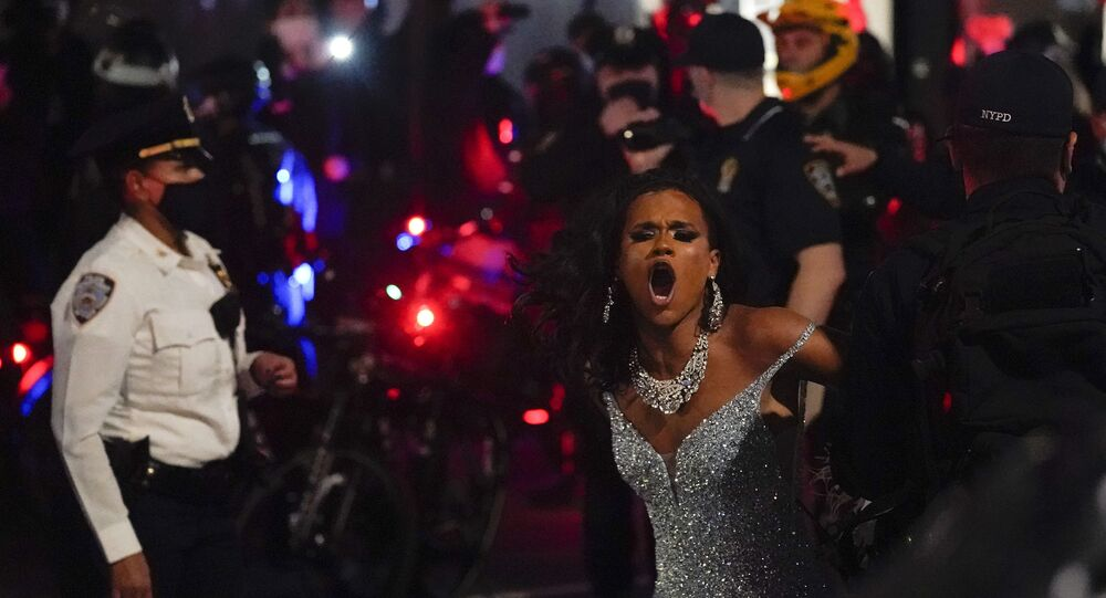 New York Police officers arrest a drag queen during a weekly We Choose Freedom march through the West Village, Thursday, Nov. 5, 2020, in New York