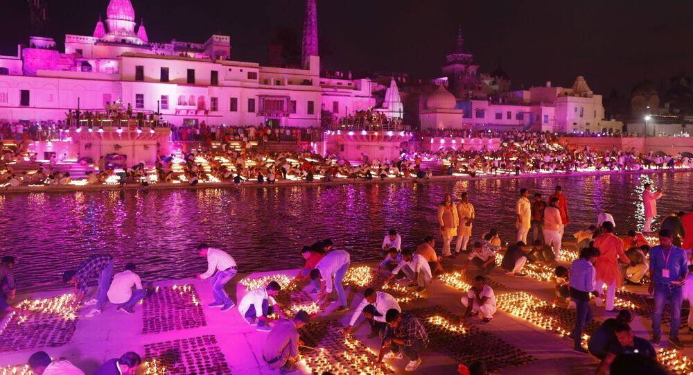 People light lamps on the banks of the river Sarayu to celebrate Diwali in Ayodhya, India, Saturday, Oct. 26, 2019
