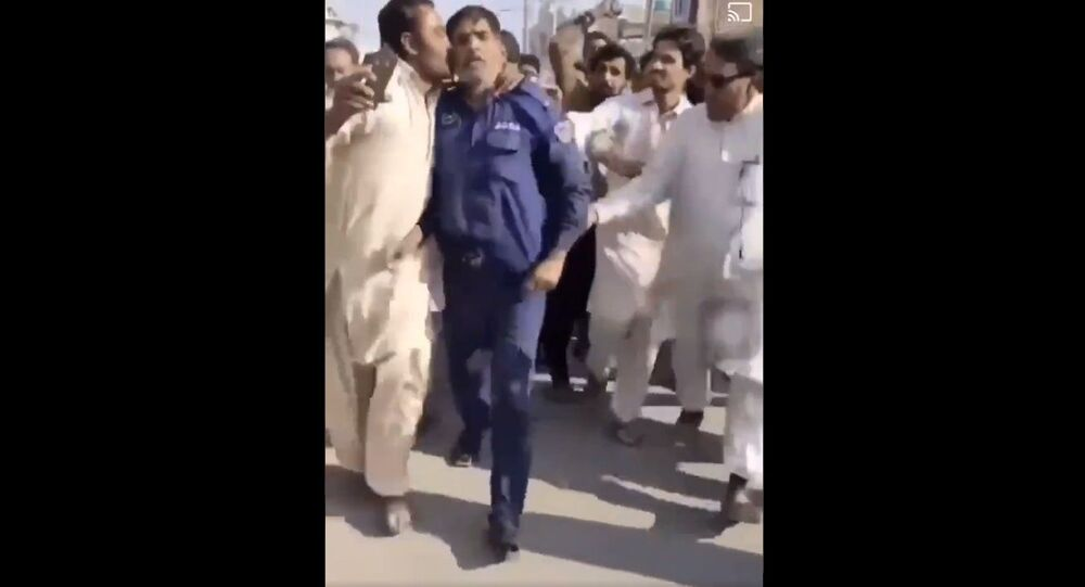 Another killing for  blasphemy in Islamic State Pakistan.  Ahmad Nawaz a security guard kills branch manager of National bank accusing him Blasphemy after heated argument. Look how he is greeted by crowd, kissing his hands with honour. All cultures or religions are not same sir