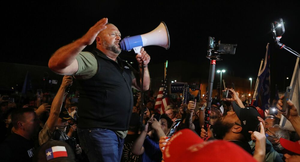 Alex Jones of Infowars speaks to supporters of US President Donald Trump gather during a protest about the early results of the 2020 presidential election, in front of the Maricopa County Tabulation and Election Center (MCTEC), in Phoenix, Arizona, US, 5 November 2020.