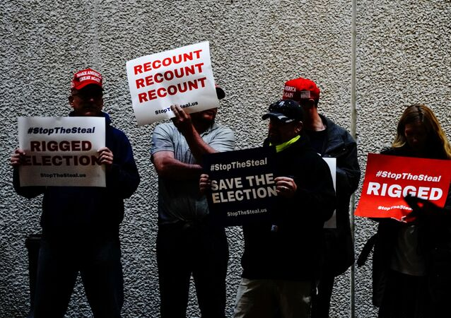 Supporters of U.S. President Donald Trump hold placards at a Stop the Steal protest outside Milwaukee Central Count the day after all of Milwaukee County's absentee ballots were counted, in Milwaukee, Wisconsin, U.S. November 5, 2020.
