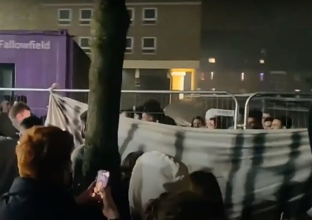 University of Manchester students tear down COVID lockdown fences
