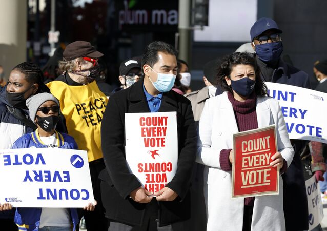 Rep, Rashida Talib(R) D-MI walks with protestors who want every vote counted from the 2020 presidential election, march down Woodward Avenue on November 4, 2020 in Detroit, Michigan.
