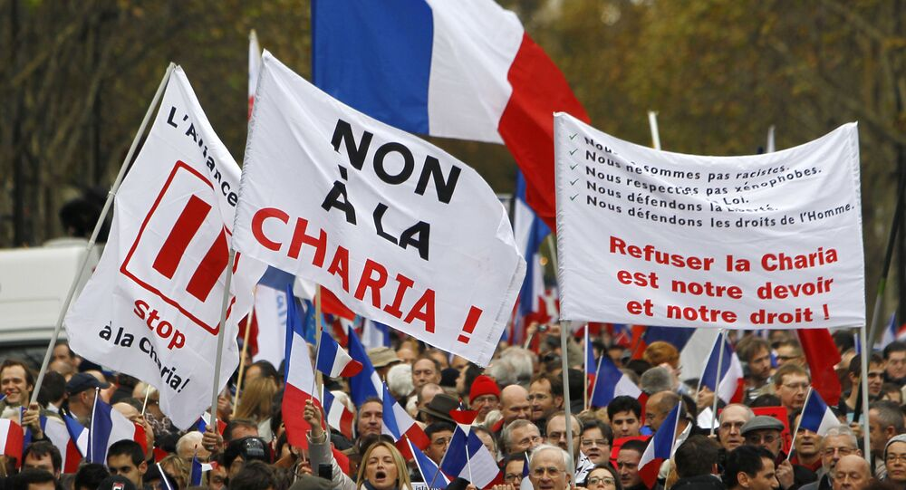 People take part in a demonstration against Islamic extremism, in Paris, file photo.