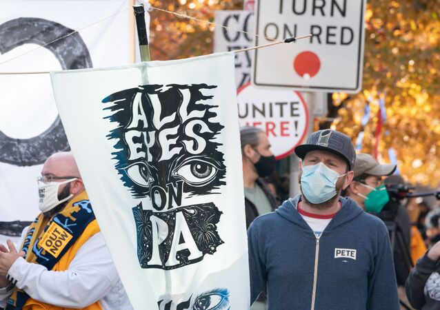 Protesters urge vote counting outside the Pennsylvania Convention Center as ballot counting continues inside on November 6, 2020 in Philadelphia.