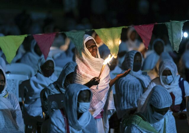 Ethiopian Orthodox Christians light candles and pray for peace during a church service at the Medhane Alem Cathedral in the Bole Medhanealem area of the capital Addis Ababa, Ethiopia Thursday, Nov. 5, 2020.