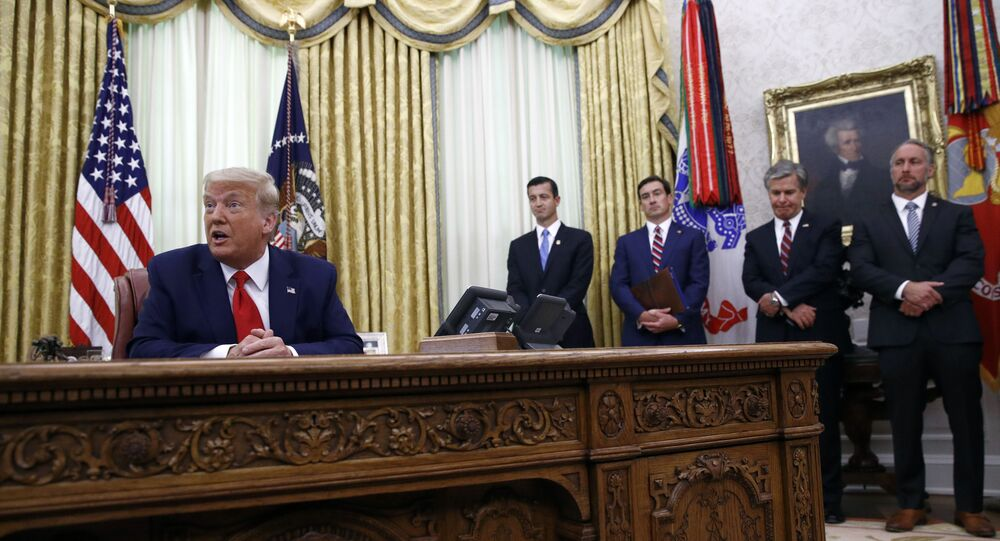 President Donald Trump speaks during a law enforcement briefing on the MS-13 gang in the Oval Office of the White House, Wednesday, July 15, 2020, in Washington. FBI Director Christopher Wray, is second from right.