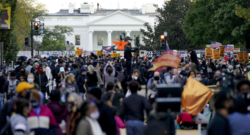 Demonstrators gather outside the White House, Tuesday, Nov. 3, 2020, in Washington