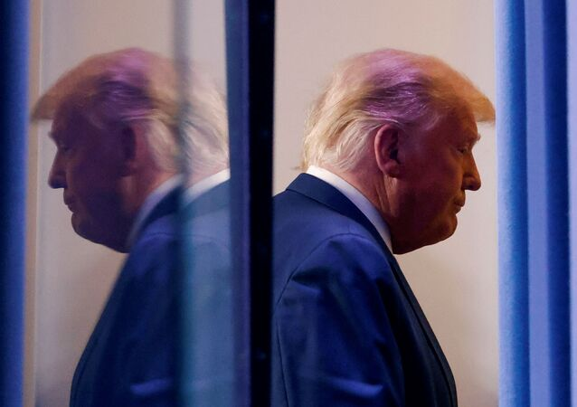 U.S. President Donald Trump is reflected as he departs after speaking about the 2020 U.S. presidential election results in the Brady Press Briefing Room at the White House in Washington, U.S., November 5, 2020.