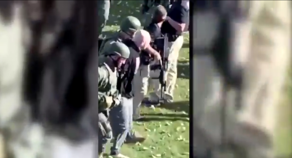 Screenshot from the video showing the moment of arrest of Nathanael Benton, a suspect in shooting of police officers in Wisconsin