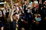 Activists cheer during a speech on a street, as votes continue to be counted following the 2020 U.S. presidential election, in Philadelphia, Pennsylvania, U.S., November 6, 2020.