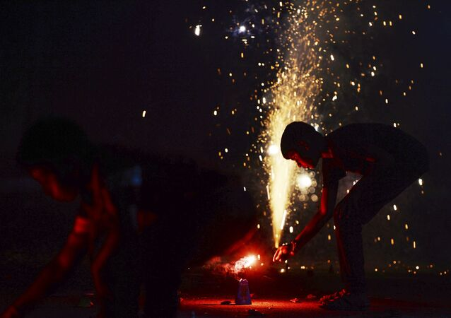 Indian kids light firecrackers during Diwali celebrations in Chennai on October 27, 2019.
