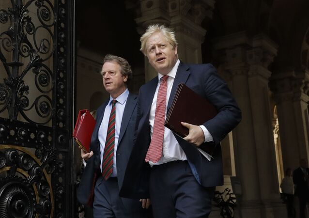 British Prime Minister Boris Johnson walks with Britain's Secretary of State for Scotland Alister Jack, left, into Downing Street, after attending a cabinet meeting at the Foreign Office in London on July 21, 2020. The countries which top the rankings of COVID-19 deaths globally are led by populist, mold-breaking leaders like Johnson. The U.S., Brazil, the United Kingdom and Mexico all are led by leaders who have been skeptical of the scientists and who initially minimized the disease. And their four countries alone account for half of the total 585,000 COVID-19 deaths worldwide so far, according to statistics tracked by Johns Hopkins University.