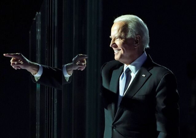 Democratic 2020 US presidential nominee Joe Biden points a finger at his election rally, after news media announced that Biden has won the 2020 US presidential election, in Wilmington, Delaware, US, 7 November 2020.