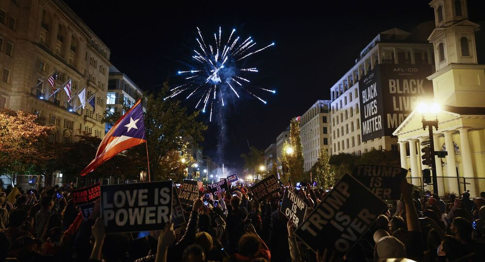 People light fireworks after news media declared Democratic candidate Joe Biden to be the winner of the 2020 U.S. presidential election, at BLM Plaza in Washington, DC, U.S., November 7, 2020