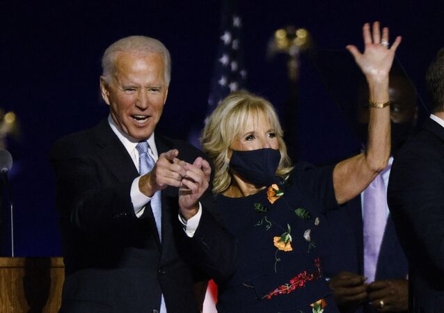Democratic 2020 U.S. presidential nominee Joe Biden and his wife Jill celebrate onstage at his election rally, after the news media announced that Biden has won the 2020 U.S. presidential election over President Donald Trump, in Wilmington, Delaware, U.S., November 7, 2020.