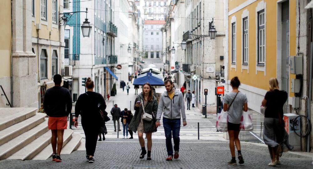 Tourists walk at Chiado neighbourhood during the coronavirus disease (COVID-19) outbreak, in downtown Lisbon Portugal 7 November 2020.