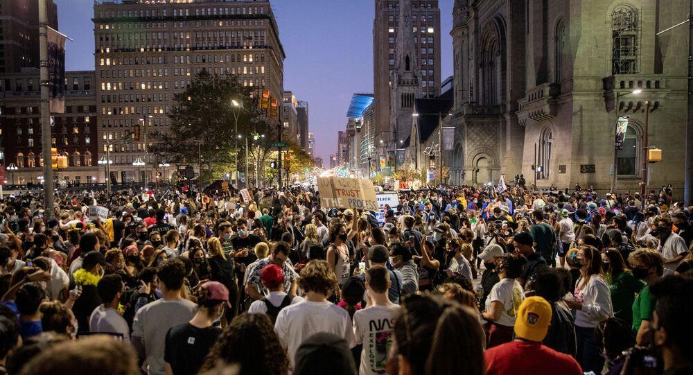 PHILADELPHIA, PENNSYLVANIA- NOVEMBER 07: People celebrate in the streets around city hall after Joe Biden was declared winner of the 2020 presidential election on November 07, 2020 in Philadelphia, Pennsylvania.