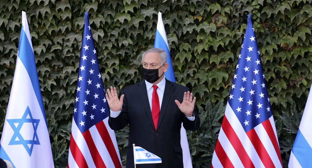Israeli Prime Minister Benjamin Netanyahu attends a ceremony to sign amendments to a series of scientific cooperation agreements with U.S. Ambassador to Israel David Friedman, at Ariel University, in the West Bank settlement of Ariel, Wednesday, Oct. 28, 2020.