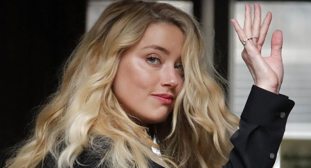US Actress Amber Heard, former wife of actor Johnny Depp, arrives at the High Court in London, Tuesday, 28 July 2020.