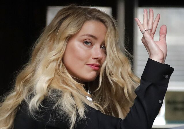 US Actress Amber Heard, former wife of actor Johnny Depp, arrives at the High Court in London, Tuesday, July 28, 2020.