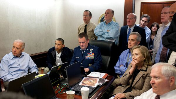 U.S. President Barack Obama (2nd L) and Vice President Joe Biden (L), along with members of the national security team, receive an update on the mission against Osama bin Laden in the Situation Room of the White House, May 1, 2011 - Sputnik International