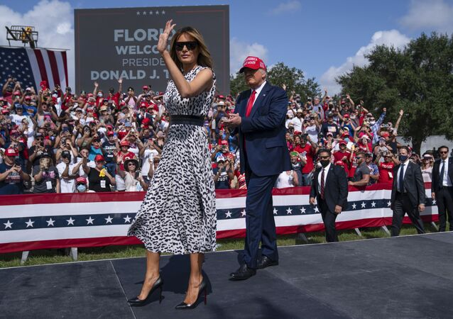 President Donald Trump and first lady Melania Trump arrive for a campaign rally outside Raymond James Stadium, Thursday, Oct. 29, 2020, in Tampa.