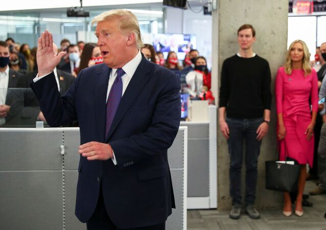 U.S. President Donald Trump speaks to staff members while his son in-law and senior advisor Jared Kushner and his White House Press Secretary Kayleigh McEnany listen as he visits his presidential campaign headquarters on Election Day in nearby Arlington, Virginia, U.S., November 3, 2020.