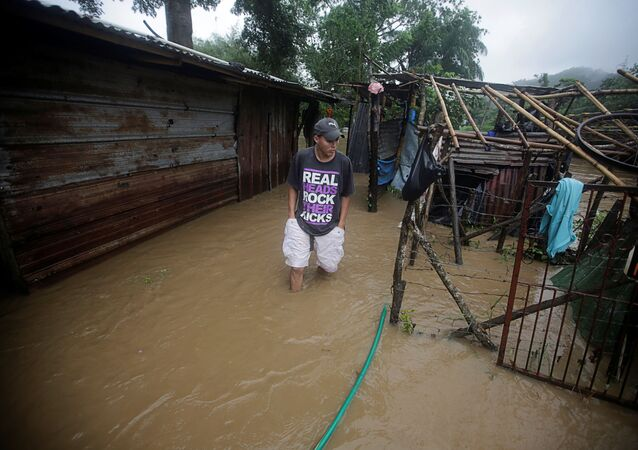 A man walks outside his house affected by a flooding caused by rains from Storm Eta, in Tela, Honduras November 4, 2020.
