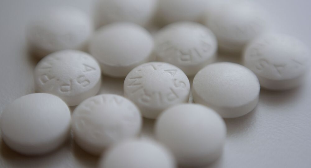 This Thursday, Aug. 23, 2018 file photo shows an arrangement of aspirin pills in New York. A new study suggests millions of people need to rethink their use of aspirin to prevent a heart attack. If you've already had a heart attack, doctors recommend taking a low-dose aspirin a day to prevent a second one. But if you don't yet have heart disease, doctors now advise routine aspirin can do more harm than good.