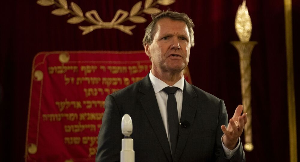 Rene de Reuver, speaking on behalf of the General Synod of the Protestant Church in the Netherlands, reads a statement at the Rav Aron Schuster Synagogue in Amsterdam, Netherlands, Sunday, Nov. 8, 2020.The Dutch Protestant Church made a far-reaching confession of guilt Sunday for its failure to do more to help Jews during and after World War II and even for the church's role in preparing the ground in which the seeds of anti-Semitism and hatred could grow. The statement came at a solemn ceremony to mark Monday's anniversary of the Nazis' anti-Jewish Kristallnacht, or Night of Broken Glass, pogrom in Germany and Austria.