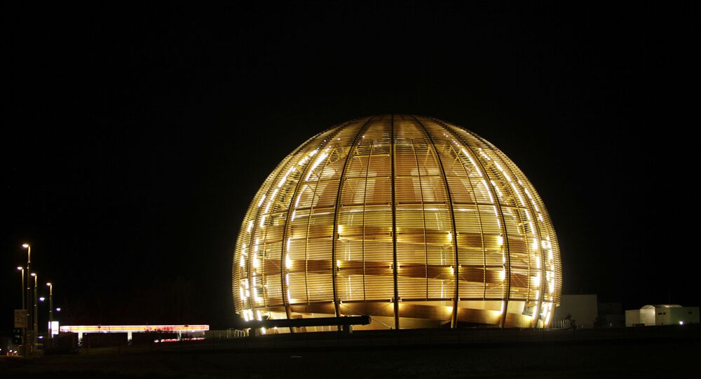 In this March 30, 2010 file picture the globe of the European Organization for Nuclear Research, CERN, is illuminated outside Geneva, Switzerland.  Two scientific teams have for the first time precisely recorded an extremely rare event in physics that adds certainty to how we think the universe began, leaders at the world's top particle physics lab said Friday July 19, 2013.  Two of the teams at the European Center for Nuclear Research, or CERN, say they measured a particle called Bs decaying into a pair of muons, a fundamental particle.  The results are being formally unveiled at a major physics conference in Stockholm later Friday.
