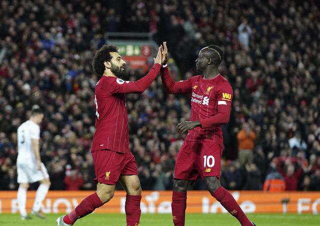 Liverpool's Mohamed Salah, front left, celebrates with Liverpool's Sadio Mane after scoring his side's opening goal during the English Premier League soccer match between Liverpool and Sheffield United at Anfield Stadium, Liverpool, England, Thursday, Jan. 2, 2020