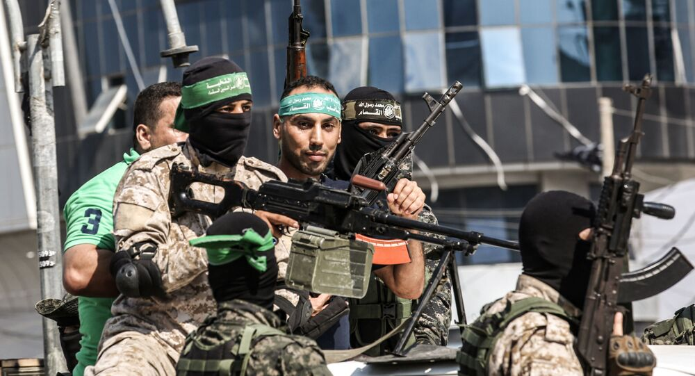 Abdel Halim Badawi (C), a Palestinian who was held for 18 years in an Israeli prison after he was convicted of being a member of Hamas' armed wing in 2001, rides in the back of a pickup truck with Hamas militants as they celebrate his release in Rafah in the southern Gaza Strip on October 17, 2019