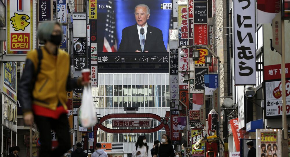 A screen shows live broadcast of President-elect Joe Biden speaking Sunday, Nov. 8, 2020 at the Shinjuku shopping district in Tokyo