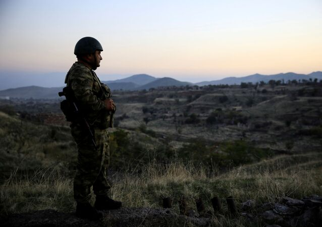 An Azeri soldier inspects the city of Cebrayil, where Azeri forces regained control during the fighting over the breakaway region of Nagorno-Karabakh, Azerbaijan October 16, 2020
