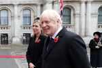 Britain's Prime Minister Boris Johnson with partner Carrie Symonds attend the National Service of Remembrance at The Cenotaph on Whitehall amid the coronavirus pandemic in London, Britain November 8, 2020