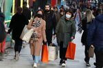 Shoppers wearing protective face masks walk on Oxford Street, after new nationwide restrictions were announced during the coronavirus disease (COVID-19) outbreak in London, Britain, November 4, 2020.