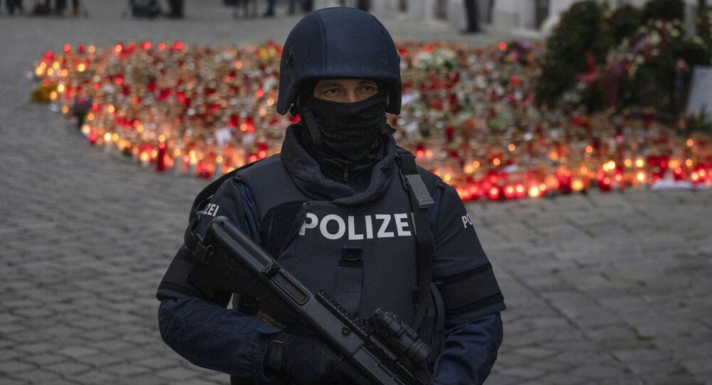 An armed police officer stands guard before the arrival of Austrian Chancellor Kurz and President of the European Council to pay respects to the victims of the recent terrorist attack in Vienna, Austria on November 9,2020.