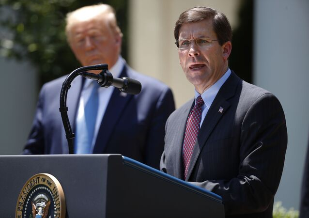 Defense Secretary Mark Esper speaks as President Donald Trump listens during a press briefing about the coronavirus in the Rose Garden of the White House, Friday, May 15, 2020, in Washington. (AP Photo/Alex Brandon)