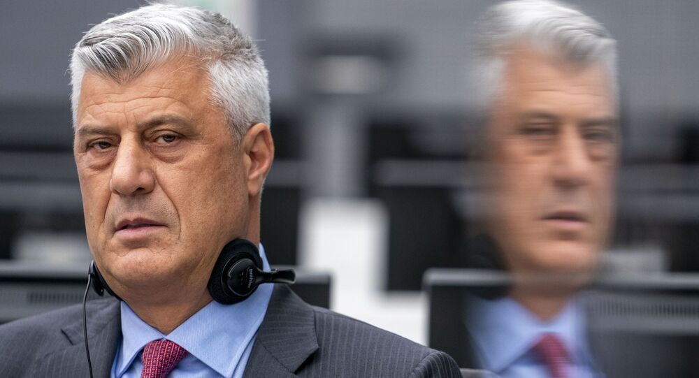 Kosovar former president Hashim Thaci sits for the first time before a war crimes court in The Hague on November 9, 2020, to face charges relating to the 1990s conflict with Serbia. - The one-time guerrilla leader, 52, who resigned as president last week, wore a grey suit and red tie for the hearing at the Kosovo Specialist Chambers in the Dutch city.