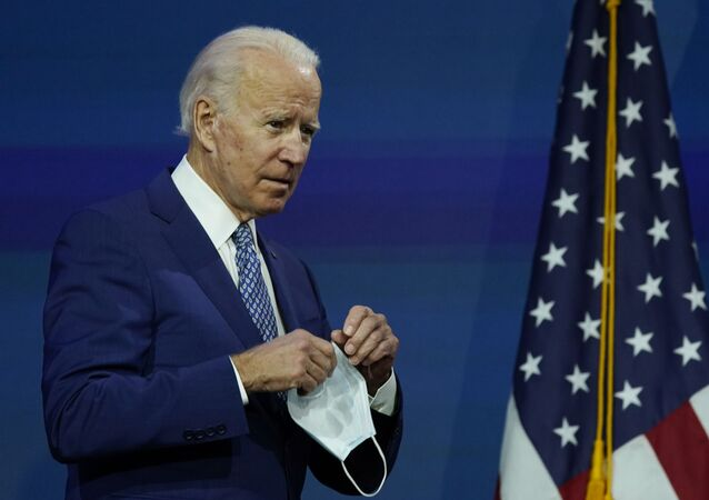 After removing his face mask as he walked on stage, President-elect Joe Biden continues to the podium to speak at The Queen theater, Monday, Nov. 9, 2020, in Wilmington, Del.