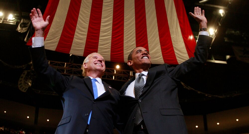 FILE PHOTO: U.S. Democratic Presidential nominee Senator Barack Obama (D-IL) and his Vice Presidential nominee Senator Joe Biden (D-DE) (L) participate in a campaign rally in Sunrise, Florida, U.S., October 29, 2008