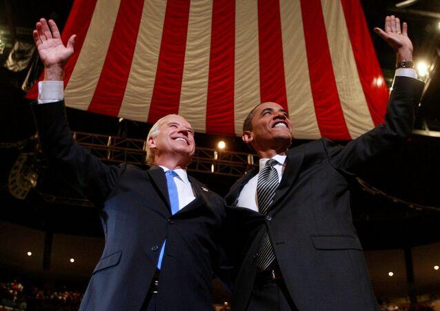 FILE PHOTO: U.S. Democratic Presidential nominee Senator Barack Obama (D-IL) and his Vice Presidential nominee Senator Joe Biden (D-DE) (L) participate in a campaign rally in Sunrise, Florida, U.S., October 29, 2008