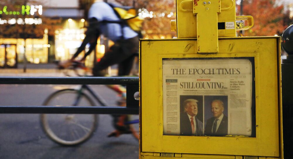 A newspaper from Thursday, Nov. 5 sits in a street box outside the Pennsylvania Convention Center in Philadelphia, where a handful of supporters of President Donald Trump continue to protest Monday, Nov. 9, 2020, two days after the election was called for Democrat Joe Biden.