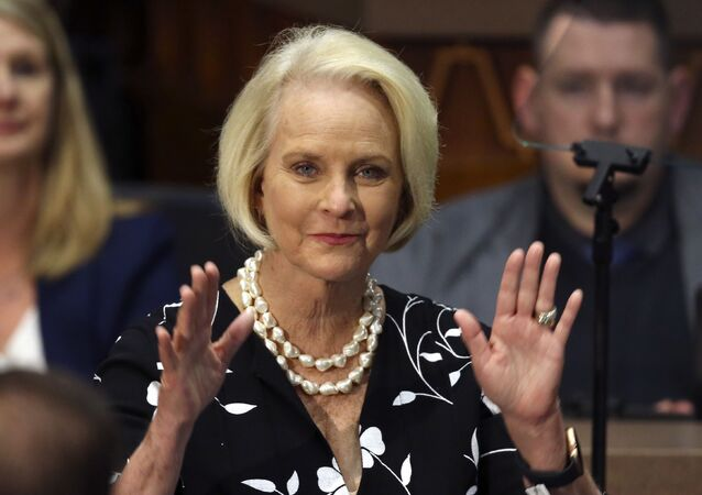 FILE - In this Jan. 13, 2020, file photo Cindy McCain, wife of former Arizona Sen. John McCain, waves to the crowd