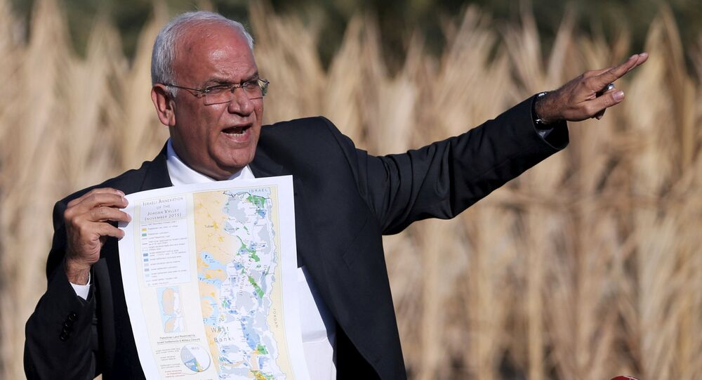 FILE PHOTO: Palestinian Chief negotiator Saeb Erekat holds a map as he speaks to media about the Israeli plan to appropriate land, in Jordan Valley near the West Bank city of Jericho, January 20, 2016