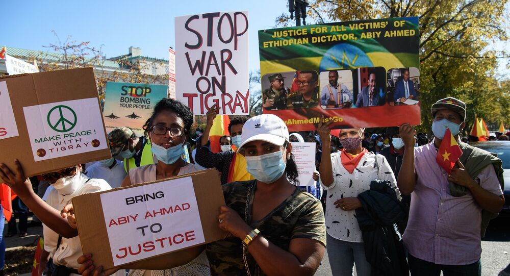 Ethiopians call for the end of the government's military actions in the Tigray region in front of the US State Department in Washington DC.