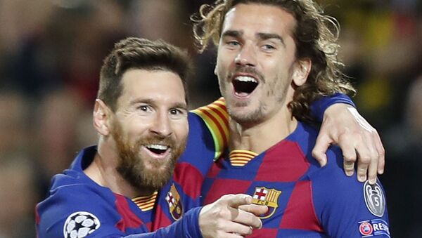 Barcelona's Lionel Messi, left, celebrates after scoring his side's second goal with Antoine Griezmann during a Champions League soccer match Group F between Barcelona and Dortmund at the Camp Nou stadium in Barcelona, Spain, Wednesday, Nov. 27, 2019 - Sputnik International