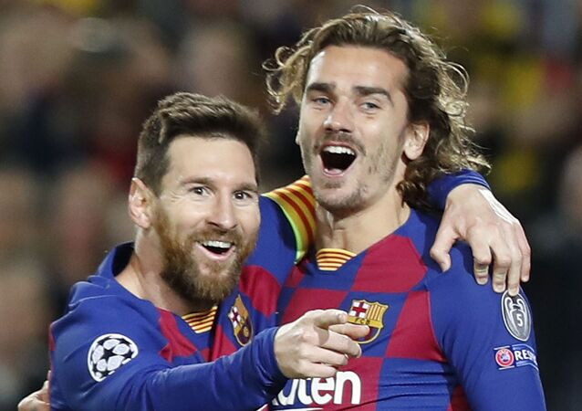 Barcelona's Lionel Messi, left, celebrates after scoring his side's second goal with Antoine Griezmann during a Champions League soccer match Group F between Barcelona and Dortmund at the Camp Nou stadium in Barcelona, Spain, Wednesday, Nov. 27, 2019